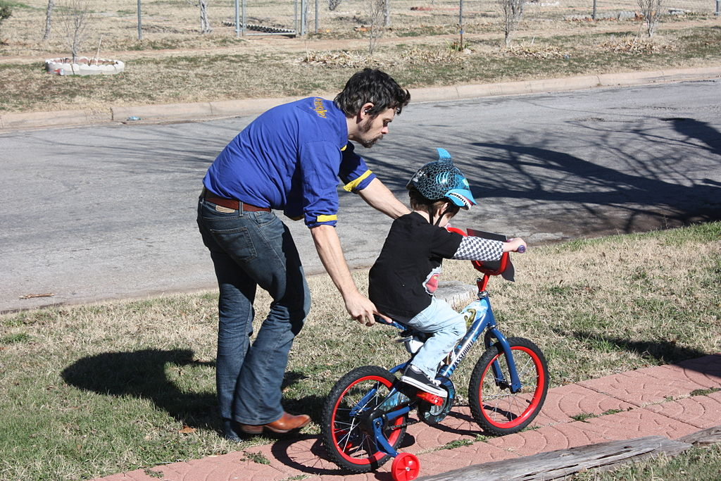 Father_and_son_learning_to_ride_a_bike!