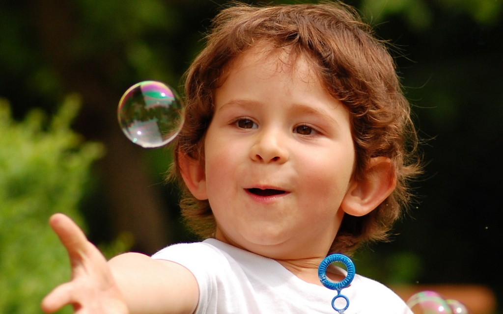 happy_child_touching_bubble